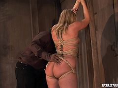 Curvaceous blonde chick strips her clothes off and then gets tied up. After that she sucks big black cock and gets fucked in the ass.