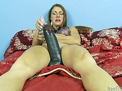 This sex-starved nympho knows how to bring some pleasure alone. She fucks her loose snatch with a massive, black dildo until she cums.