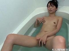 Slim Japanese girl fondles her tits and vagina while taking the bath. Later on she takes a dildo and starts to shove it in her pussy.