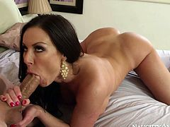 Extra voluptuous black haired beauty Kendra Lust was lying in bed feeling sad till she felt huge cock in her hands. She took off her rode and started to suck that meat pole flaunting her huge ass.