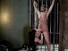 Maitresse Madeline and sexy brunette Princess Donna Dolore are having fun in a basement. Maitresse gets bound by Donna and then enjoys clothes pegs on her tits and a toy in her snatch.