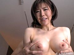Curvaceous Japanese chick gets her boobs licked and pussy fingered. Later on she gives skillful blowjob and gets fucked on the floor.