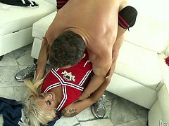 Horny football coach fucks this cheerleader in and out loosening her once tight hole. Damn, I've never seen anything like this.