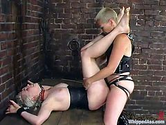 Nasty blonde girl Lorelei Lee is having fun with short-haired dominatrix Trixie. Trixie binds and tortures Lorelei and then destroys her coochie with a strapon.