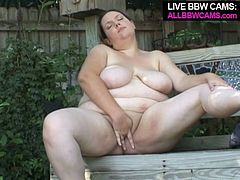 Kinky brunette bitch with huge saggy boobs rubs her pussy intensively