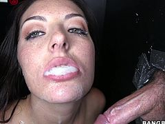 Stunning brunette girl stands on her knees and sucks several dicks. In addition she also gets fucked through the hole in the wall. She also gets her mouth filled with cum.