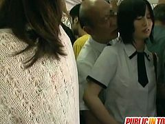Innocent looking asian girl is abused by a horny man in a train. Man strats rubbing her pussy and before you know it he fucks her right there in front of everybody.