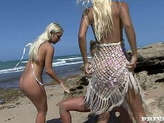 Passionate women with gorgeous gorgeous bodies caress one another on a beach under the open sky. They perform extremely exciting lesbo 3some. Oh boy, I am dying to join those babes.