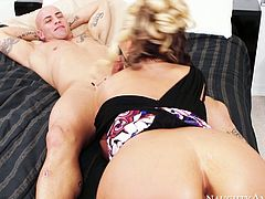 Hot blooded blond mature climbs on a kinky dude to ride his sturdy cock in cowgirl style after she pleases him with blowjob in peppering sex video by Naughty America.