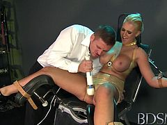 BDSM XXX Master straps big tits submissive girl to a gyno chair and pleasures her