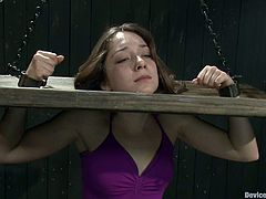 This kinky and smoking hot babe Remy LaCroix is being humiliated so fucking bad! She gets tied up on the device and her master bangs her twat with a toy!
