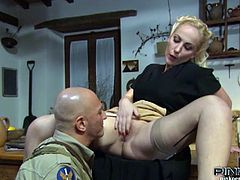 Blonde housewife Monica Preziosi gets her pussy eaten by a horny soldier. She opens her legs and he licks and eats that wet pussy till orgasm.