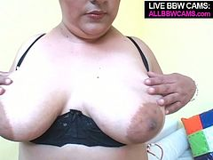 Frisky BBW harlot lies on a couch wearing black lingerie set. She caresses her body tracing hands all over. She slips her hand under black knickers fondling her wet pussy. After pleasing herself she gets to the cock of her sex partner. Saucy bitch sucks his dick deepthroat.