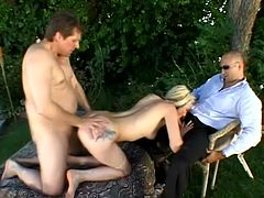 Check out this rough hardcore scene where this slutty blonde ends up with a serious mouthful of cum after a threesome while her man watches.