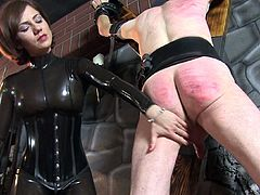 Beauty in latex is spanking his ass