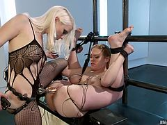 Check out these two fucking blonde sluts! They really like it hardcore and we get to see them in action! One of the bitches it tied hard and putted to suck her mistresses feet before getting stepped on her pussy, shocked and fucked. She loves it and a few harder electrical shocks will make her a lot happier!