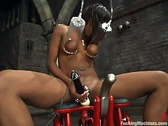 Ebony sweetie Erica Sommers is having fun in a basement. She shows off her nice body and strokes it and then gets her poontang smashed by a sex machine.