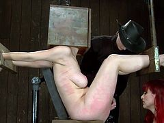 The mistresses are not after only her pussy and boobs, these skilled whores know how to destroy Mz Berlin's self esteem too and do it in a very specific manner. They keep a box on her head and play with that bald cunt, teasing and arousing Berlin until she reaches her limit. Then they apply another treatment