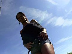 Appealing black chick with pretty face and fit body gives a head outdoor at the sunny day. Then she takes off her shorts and panties getting on top of hard dong. She rides the stick actively and later she gets nailed hard doggy style.