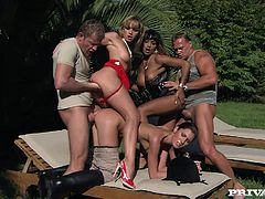 Josette Most, Kathy Campbel and Loona Luxx are having fun with two men in the garden. They drive the studs crazy with blowjobs and then jump on their weiners by turns.