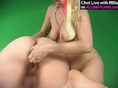 Saucy BBW harlot stands on her all four serving her coochie to seductive blonde porn model. The latter stuffs wet clam with smooth dildo poking intensively.