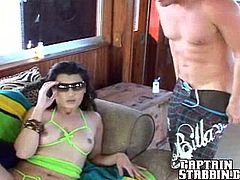 Sexy Devon stands on her knees and gives nice blowjob. After that she lies down on a sofa and gets her shaved pussy fucked.