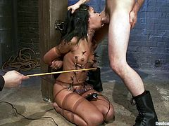 Smoking hot and exotic chick Skin Diamond is being humiliated! She gets twitched, toyed, dipped and even trapped in the iron device!