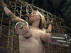 This sizzling and horny blond babe Adrianna Nicole gets naked for BDSM perversions. So, babe gets suspended and trapped in the rope net.