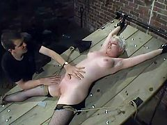 There is a table with handcuffs on its corners. Two for arms and two for legs. Cowgirl and Rose get tied up on it and vibrated in their snatches one by one.