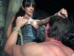 Sexy brunette mistress in latex uniform gets her pussy licked by Eddy. Then she ties up and tortures this dude. After that she also gets her pussy fucked properly.