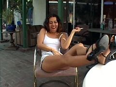 Ruined cheap Latin whore sits in the cafe with legs placed on the table and smokes cigarette before big dicked black fucker approaches her and forces her give him a head.