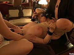 So here is the dinner table, where guests are enjoying the show. Sexy chicks are getting ball gagged and crossed one by one.