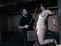 Sexy blondie gets tied up to the bondage device. After that the guy whips her ass and toys her pussy. This girl also gets gagged with spider gag.
