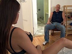 Bald headed due enjoys blowjob by one kinky and well stacked hoochie. He has no idea that this babe has something interesting between her legs. And it's not a pussy.