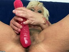 Naughty grandma is craving for sex. She rubs her pussy while sucking dildo like real cock. She dreams of hard flesh in her mouth while sucking fake dick. Horny old woman inserts smooth tool in her hairy clam pushing it deep inside.