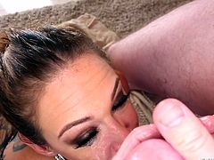Mom Tory knows how to suck it! She sucks this guy's big balls, his cock and his friend's cock. The milf does a great job satisfying the men so they repay her with a few big loads of cum on her slutty face. As jizz drips from her face she looks at the camera and fools around with the semen. Maybe she needs more
