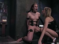 Kinky brunette Bronte is having fun with Maitresse Madeline indoors. Maitresse binds Bronte and attaches wires all over her body and then smashes her snatch with a dildo.