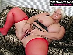 Hussy jade appears on screen wearing tight black corset, red nylon stockings and high heel shoes. She poses for cam demonstrating her voluptuous body. After posing she stuffs her cunt with some tool that stretches her vagina.