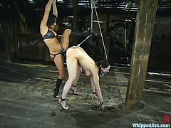 Two hot brunettes Dana Dearmond and Sandra Romain are getting naughty in a shed. The mistress binds her slave and torments her and then stuffs her butt with a hook and smashes her snatch with a strapon.