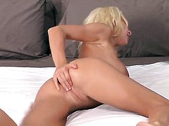 Devon Alexis with massive breasts and shaved bush cant stop fingering her honeypot