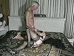 A kinky brown-haired mom wearing stockings is having fun with some grey-haired guy indoors. The slut shows her cock-sucking talent to the man and then gets banged doggy style.