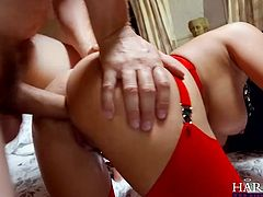 This brunette temptress is one of those chicks who likes to be fucked hard in the ass. Horny stud pounds her tight butthole in doggy position. Then she rides him in cowgirl position. The way her huge delicious boobs bounce up and down guarantee his dick won't go limp.