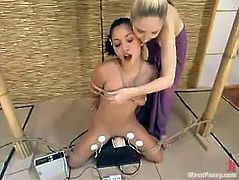 Sexy bitch Roxy Jezel allows her GF to tie her up indoors and stuff her nice pussy with some wired toys. Then she sits down on a fucking machine and takes a nice ride on it.