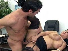 Secretary around oustanding tits fucks her coworker inside the office.