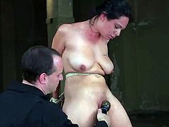 Amazing dark-haired girl Jessica gets bound by some man in a basement. The dude rubs the chick's vag with a vibrator and makes her get an orgasm soon.