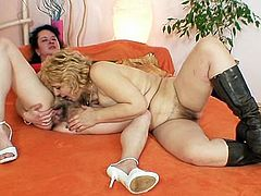 Big natural breasts grandmother is very sexy and still unsatisfied so she seduces another blonde old mother and they screw each other plus a huge strap on toy