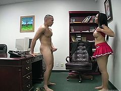 Brown-haired hottie Lydia Love wearing a cheerleader uniform is having fun with some dude in an office. She shows her tits to the man and then rubs his wang shyly.