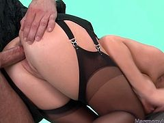 Wearing a beautiful lingerie set with pantyhose and garters, she lusts for pleasure. Horny stud pounds her fanny in and out mercilessly in and out loosening her once tight hole.