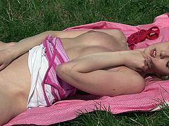 Slim babe enjoys large toy deep in her shaved pussy during top outdoor solo