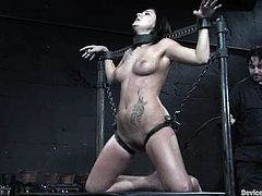 This smoking hot and busty babe Dylan Ryan is so fucking sore in this BDSM session. She gets tied up and then he drips some hot wax on her tits.